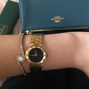 Vintage gold plated Gucci lady black dial watch